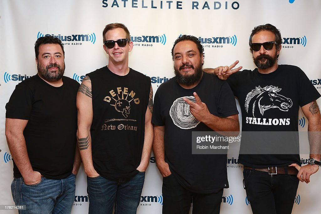 Tito Fuentes, Mickey Huidobro, Paco Ayala and Randy Ebright of Latin rock band Molotov visit the SiriusXM studios to promote the Jagermeister Music Tour on August 27, 2013 in New York City.