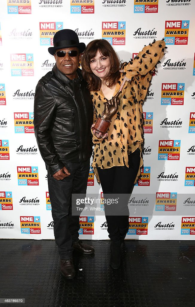 Tito Jackson and Viv Albertine pose with the award for Book of the Year in the winner's room at the NME Awards at Brixton Academy on February 18 2015...