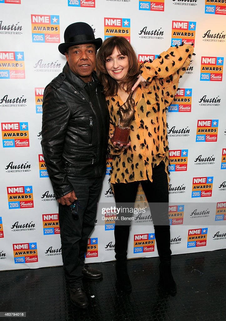 Tito Jackson and Viv Albertine pose with the award for Book of the Year poses in the winner's room at the NME Awards at Brixton Academy on February 18, 2015 in London, England.