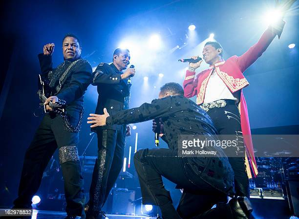 Tito Jackson Jackie Jackson and Jermaine Jackson and Marlon Jackson of The Jacksons perform on stage at BIC on March 2 2013 in Bournemouth England