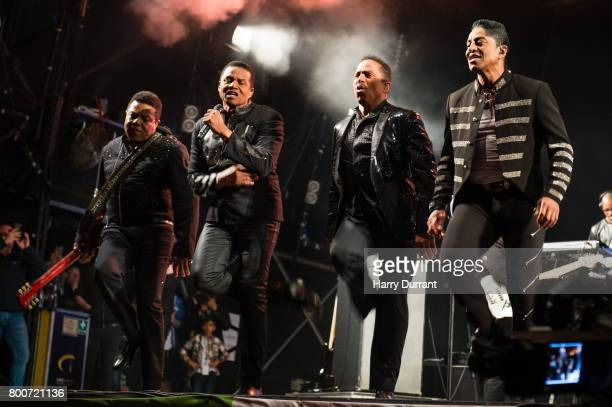 Tito Jackson Jackie Jackson Marlon Jackson and Jermaine Jackson from The Jacksons performs on the West Holts Stage on day 3 of the Glastonbury...