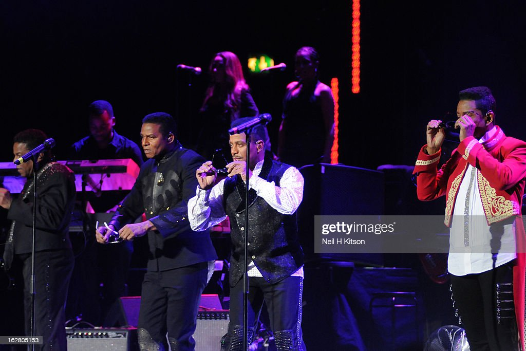 Tito Jackson, Jackie Jackson, Marlon Jackson and Jermaine Jackson of the Jacksons perform on stage in concert at Manchester Apollo on February 27, 2013 in Manchester, England.