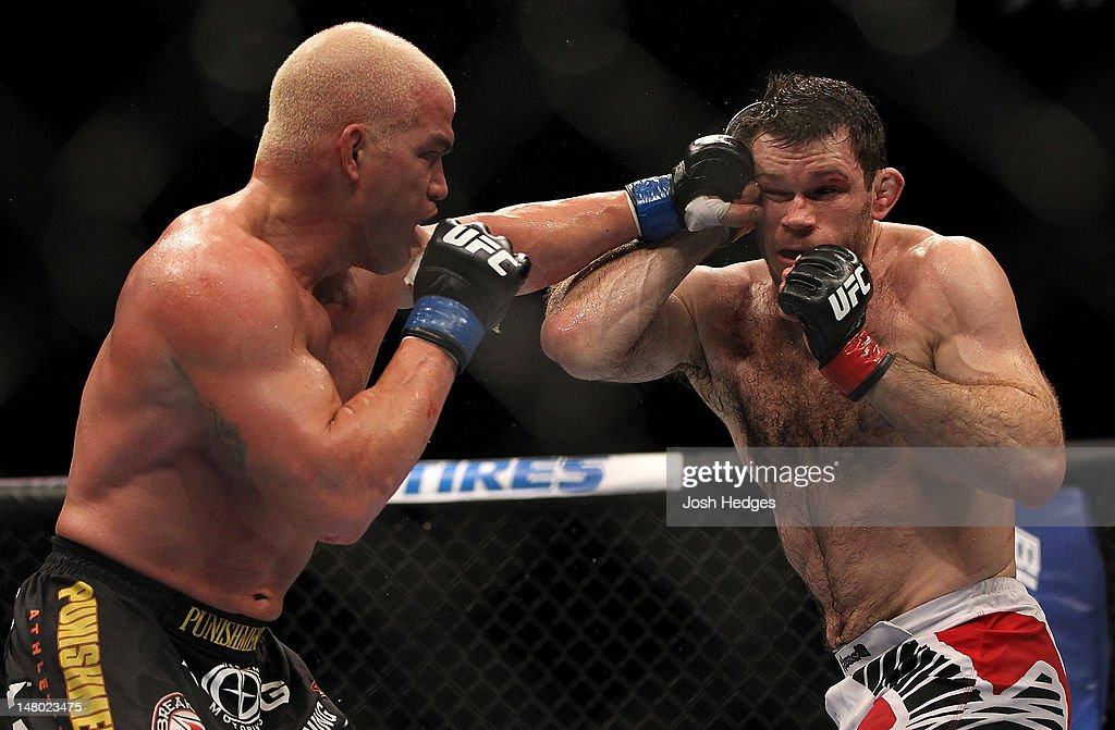 Tito Ortiz punches Forrest Griffin during their light heavyweight bout at UFC 148 inside MGM Grand Garden Arena on July 7, 2012 in Las Vegas, Nevada.