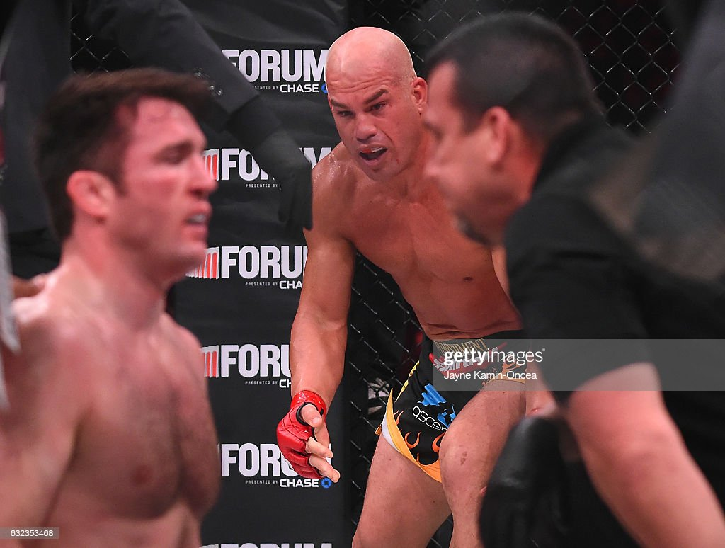 Tito Ortiz (red gloves) reacts as referee John McCarthy checks on Chael Sonnen (blue gloves) after stopping their Bellator MMA light heavyweight fight in round one of at The Forum on January 21, 2017 in Inglewood, California. Ortiz won in the first round.