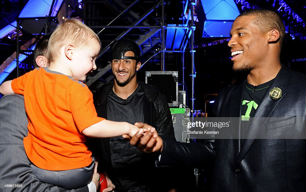 Titus Ashby with co-hosts Colin Kaepernick and Cam Newton attend Cartoon Network's fourth annual Hall of Game Awards at Barker Hangar on February 15, 2014 in Santa Monica, California.