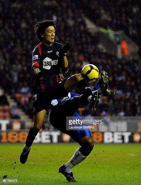 Titus Bramble of Wigan battles with ChungYongLee of Bolton during the Barclays Premier League Match between Wigan Athletic and Bolton Wanderers at DW...