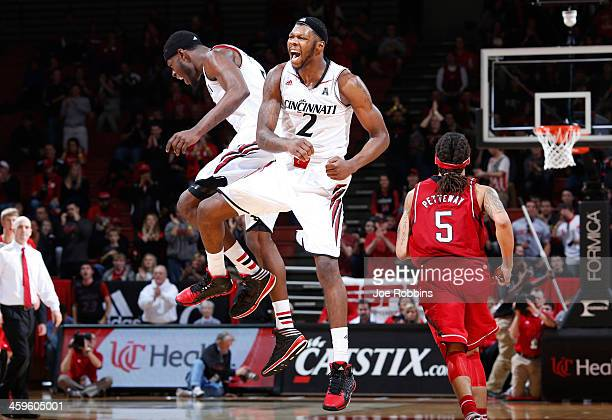 Titus Rubles and Justin Jackson of the Cincinnati Bearcats celebrate against the Nebraska Cornhuskers during the game at Fifth Third Arena on...