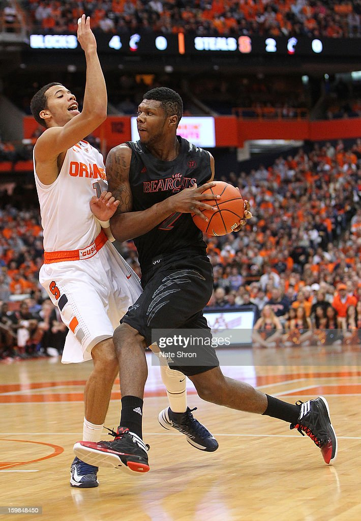 Titus Rubles #2 of the Cincinnati Bearcats drives to the basket against <a gi-track='captionPersonalityLinkClicked' href=/galleries/search?phrase=Michael+Carter-Williams&family=editorial&specificpeople=7621167 ng-click='$event.stopPropagation()'>Michael Carter-Williams</a> #1 of the Syracuse Orange during the game at the Carrier Dome on January 21, 2013 in Syracuse, New York.