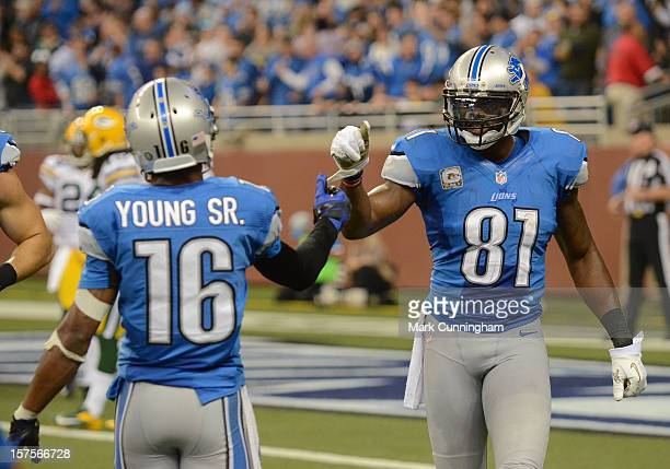 Titus Young and Calvin Johnson of the Detroit Lions shake hands after a touchdown during the game against the Green Bay Packers at Ford Field on...