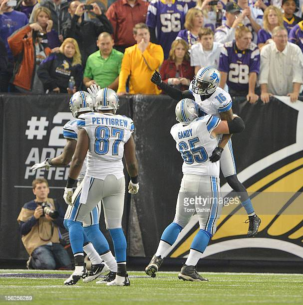 Titus Young and Dylan Gandy of the Detroit Lions celebrate during an NFL game against the Minnesota Vikings at Mall of America Field at the Hubert H...