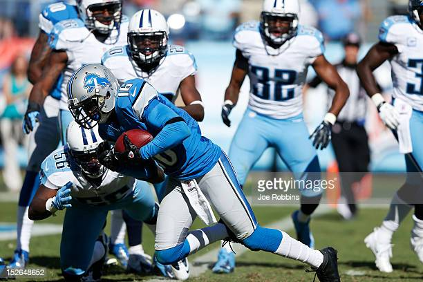 Titus Young of the Detroit Lions catches a Hail Mary pass at the end of regulation play against at the Tennessee Titans at LP Field on September 23...