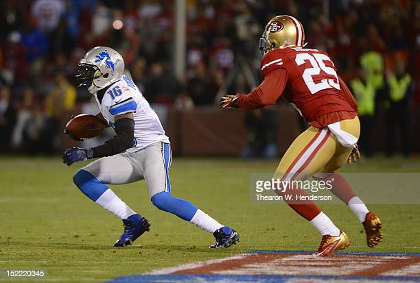 Titus Young of the Detroit Lions catches a short pass and runs away from Tarell Brown of the San Francisco 49ers during the fourth quarter of an NFL...