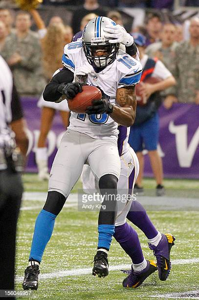 Titus Young of the Detroit Lions catches a touchdown pass in front of AJ Jefferson of the Minnesota ViKings in the fourth quarter on November 11 2012...