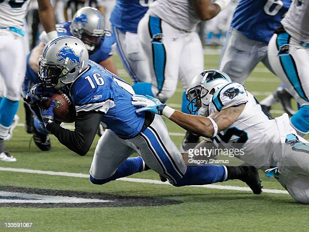 Titus Young of the Detroit Lions gets in for a second quarter touchdown past Cletis Gordon of the Carolina Panthers at Ford Field on November 20 2011...