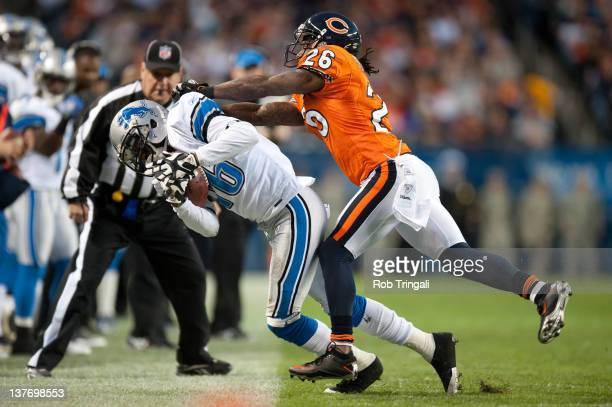 Titus Young of the Detroit Lions is pushed out of bounds by cornerback Tim Jennings of the Chicago Bears during the game between the two teams at...