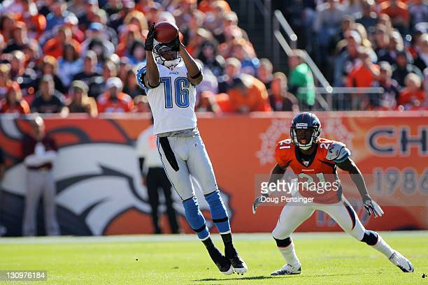 Titus Young of the Detroit Lions makes a reception for a first down over Andre' Goodman of the Denver Broncos during the first quarter at Sports...