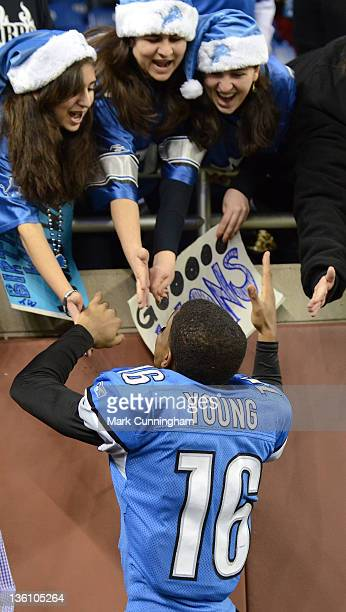 Titus Young of the Detroit Lions shakes hands with fans after the victory against the San Diego Chargers at Ford Field on December 24 2011 in Detroit...