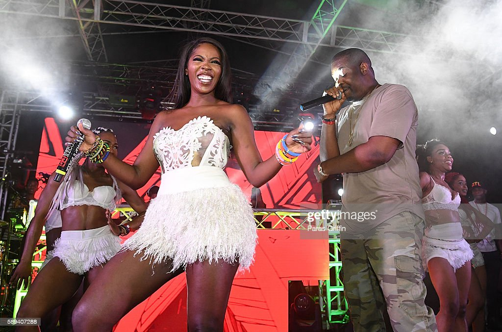Tiwa Savage and Don Jazzy perform onstage at 2016 Passport Experience Festival at Centennial Olympic Park on August 13 2016 in Atlanta Georgia