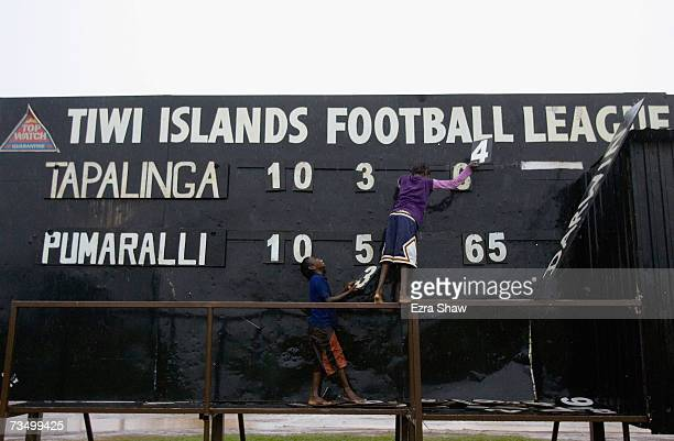 Tiwi Island residents adjust the scoreboard during an Australian Rules football match at their local oval March 5 2007 on the Tiwi Island Australia...