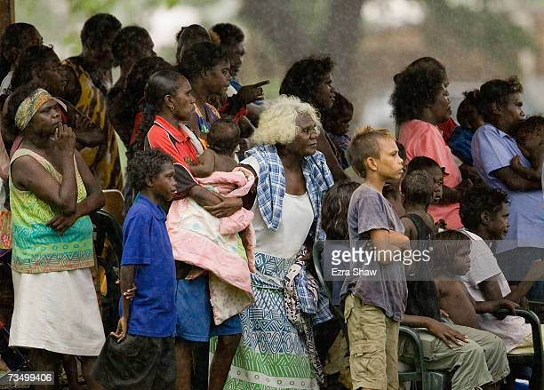 Tiwi Island residents watch a game of Australian Rules football at their local oval March 5 2007 on the Tiwi Island Australia Australian Rules...