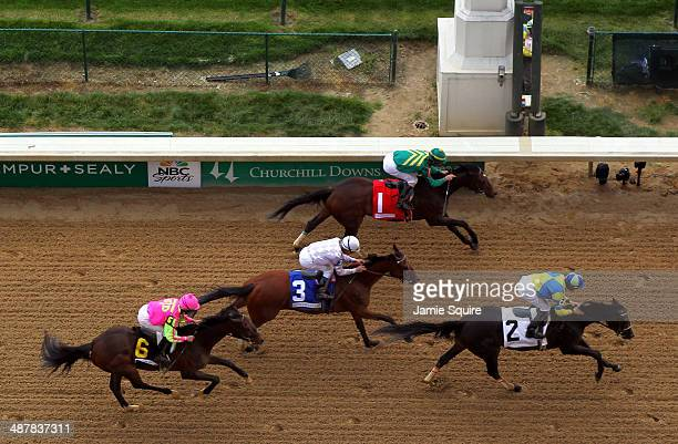 Tiz Windy leads Handmade and Flipcup across the finish line to win the 3rd race ahead of the 140th Kentucky Oaks at Churchill Downs on May 2 2014 in...