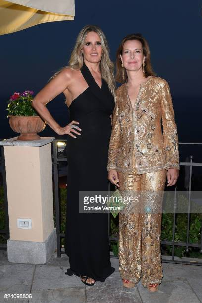 Tiziana Rocca and Carole Bouquet attend Nations Award gala dinner on July 28 2017 in Taormina Italy