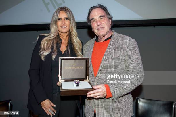 Tiziana Rocca and director Oliver Stone receives the Baume and Mercier Special Award at the Filming on Italy By Baume Mercier on February 3 2017 in...