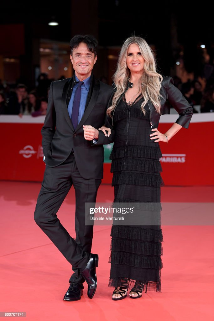 Tiziana Rocca and Giulio Base walk a red carpet for Hostiles during the 12th Rome Film Fest at Auditorium Parco Della Musica on October 26, 2017 in Rome, Italy.