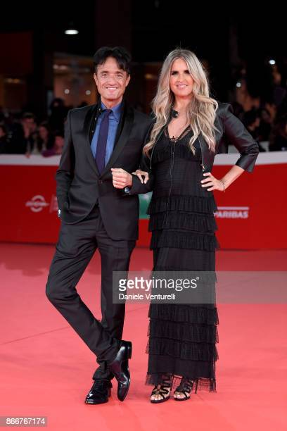 Tiziana Rocca and Giulio Base walk a red carpet for Hostiles during the 12th Rome Film Fest at Auditorium Parco Della Musica on October 26 2017 in...