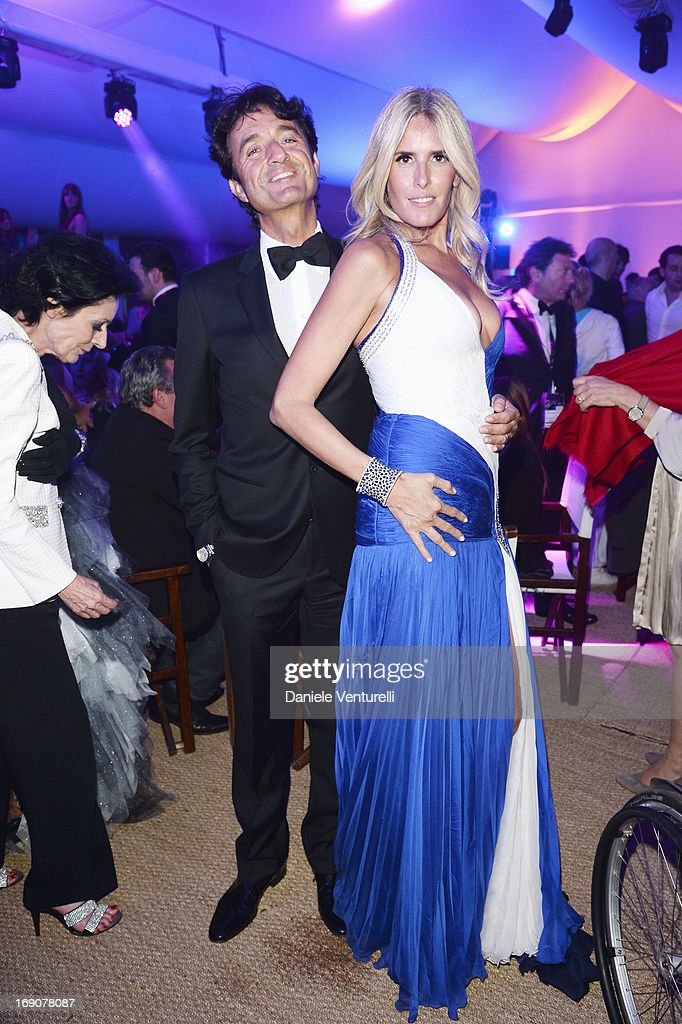 <a gi-track='captionPersonalityLinkClicked' href=/galleries/search?phrase=Tiziana+Rocca&family=editorial&specificpeople=863159 ng-click='$event.stopPropagation()'>Tiziana Rocca</a> (R) and her husband <a gi-track='captionPersonalityLinkClicked' href=/galleries/search?phrase=Giulio+Base&family=editorial&specificpeople=863157 ng-click='$event.stopPropagation()'>Giulio Base</a> attend the Eva Longoria Global Gift Gala after party hosted by Nikki Beach Cannes during The 66th Annual Cannes Film Festival on May 19, 2013 in Cannes, France.