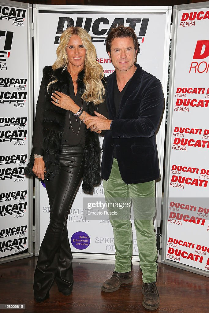 <a gi-track='captionPersonalityLinkClicked' href=/galleries/search?phrase=Tiziana+Rocca&family=editorial&specificpeople=863159 ng-click='$event.stopPropagation()'>Tiziana Rocca</a> and Paolo Conticini attend the 'Indovina Chi Viene A Natale' party at Ducati Caffe on December 19, 2013 in Rome, Italy.