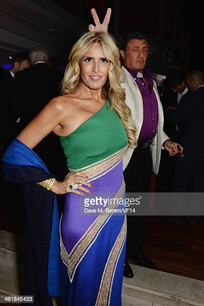 Tiziana Rocca and Sylvester Stallone attend the Vanity Fair And Armani Party at the 67th Annual Cannes Film Festival on May 17 2014 in Cap d'Antibes...