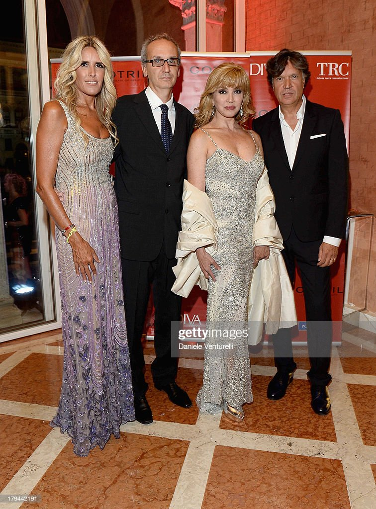 <a gi-track='captionPersonalityLinkClicked' href=/galleries/search?phrase=Tiziana+Rocca&family=editorial&specificpeople=863159 ng-click='$event.stopPropagation()'>Tiziana Rocca</a>, Angelo Ascoli, Milly Carlucci and Marco Artesani attend 'Diva e Donna' Party during the 70th Venice International Film Festival at Centurion Palace Hotel on September 3, 2013 in Venice, Italy.