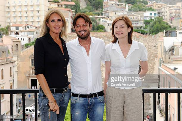 Tiziana Rocca Toto Schillaci and Deborah Young attend the Taormina Film Fest 2010 Photocall on June 14 2010 in Taormina Italy