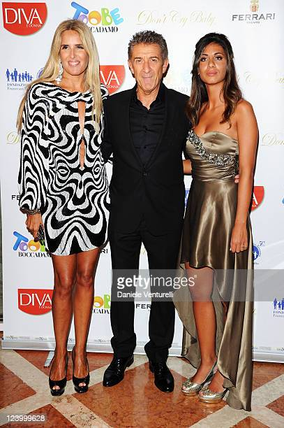 Tiziana Rooca Ezio Greggio and Aida Yespica attend the 'Diva e Donna' and 'Too Be Boccadamo' Party on September 7 2011 in Venice Italy