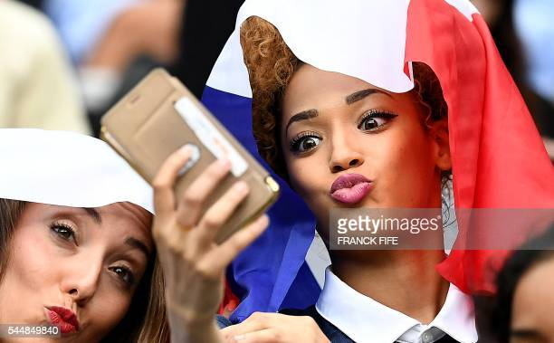 Tiziri Digne the wife of France's defender Lucas Digne and Sephora Coman wife of France's forward Kingsley Coman take a selfie prior to the Euro 2016...