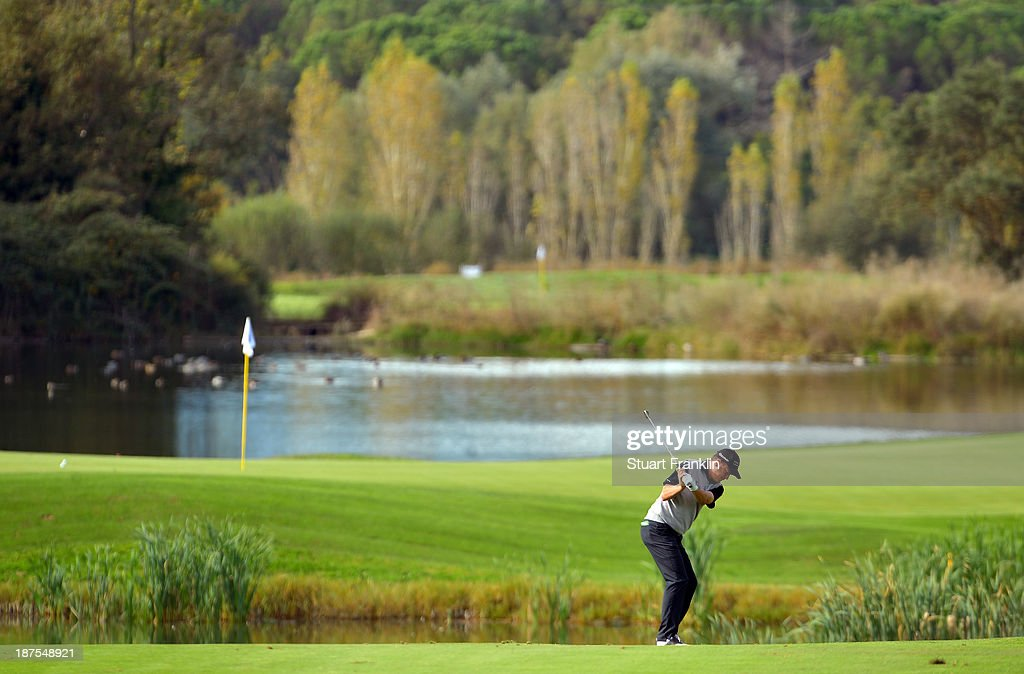 Tjaart Van der Walt of South Africa plays a shot during the first round of European Tour qualifying school final stage at PGA Catalunya Resort on November 10, 2013 in Girona, Spain.