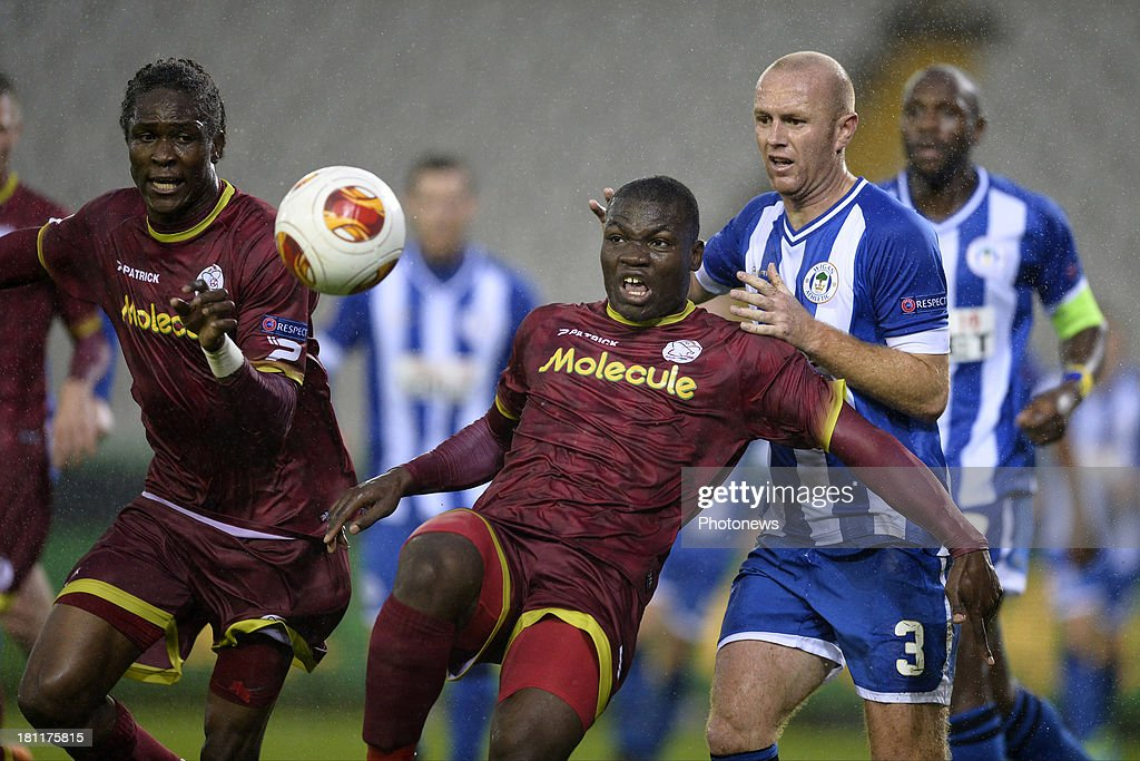 Tjakke Stevens of Zulte-Waregem battles for the ball with Stephen Crainey of Wigan Athletic during the UEFA Europa League group D - matchday 1 match between SV Zulte Waregem and Wigan Athletic FC at Jan Breydel stadium on September 19, 2013 in Bruges, Belgium.