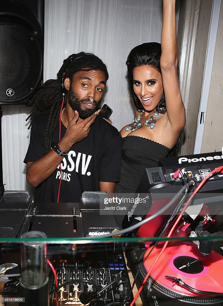 DJ Tjani and <a gi-track='captionPersonalityLinkClicked' href=/galleries/search?phrase=Lilly+Ghalichi&family=editorial&specificpeople=8521894 ng-click='$event.stopPropagation()'>Lilly Ghalichi</a> pose for photos at Avenue Nuit on June 28, 2014 in Long Branch, New Jersey.