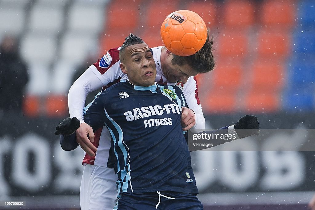 Tjaronn Chery of ADO Den Haag, Jordens Peters of Willem II during the Dutch Eredivise match between Willem II and ADO Den Haag at the Koning Willem II Stadium on January 20, 2013 in Tilburg, The Netherlands.