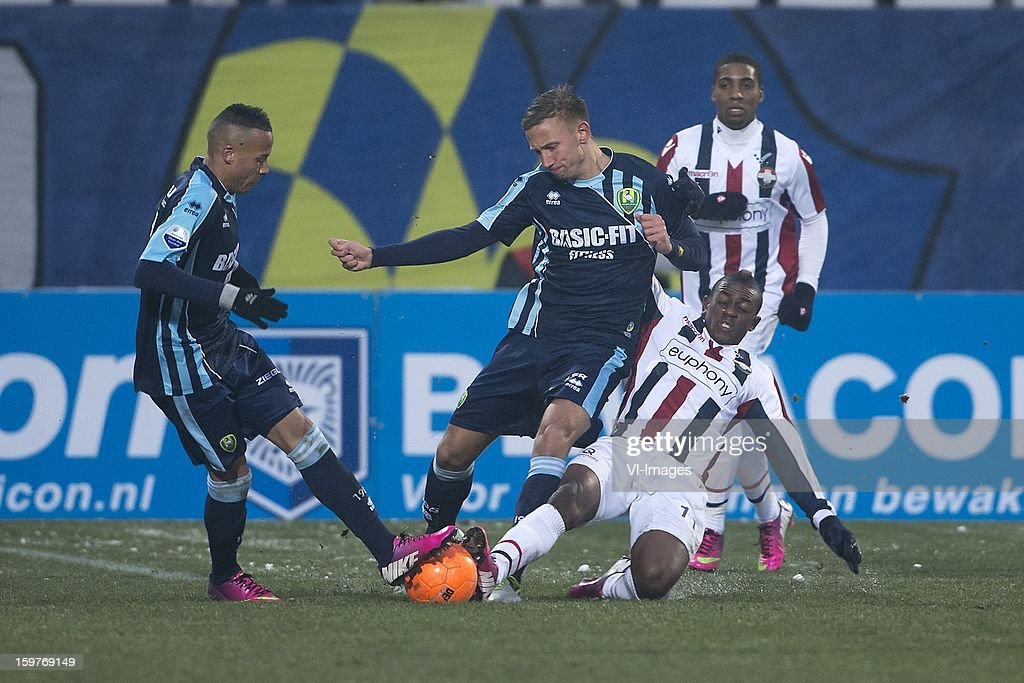 Tjaronn Chery of ADO Den Haag, Kevin Visser of ADO Den Haag, Virgil Misidjan of Willem II during the Dutch Eredivise match between Willem II and ADO Den Haag at the Koning Willem II Stadium on January 20, 2013 in Tilburg, The Netherlands.