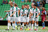 Tjaronn Chery of Groningen is congratulated by team mates after scoring the second goal of the game during the pre season friendly match between FC...