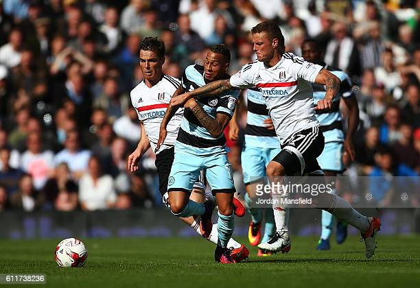 Tjaronn Chery of QPR tackles with Ragnar Sigurdsson of Fulham during the Sky Bet Championship match between Fulham and Queens Park Rangers at Craven...