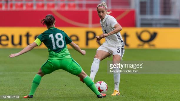 Tjasa Tibaut of Slovenia challenges Kathrin Hendrich of Germany during the 2019 FIFA women's World Championship qualifier match between Germany and...