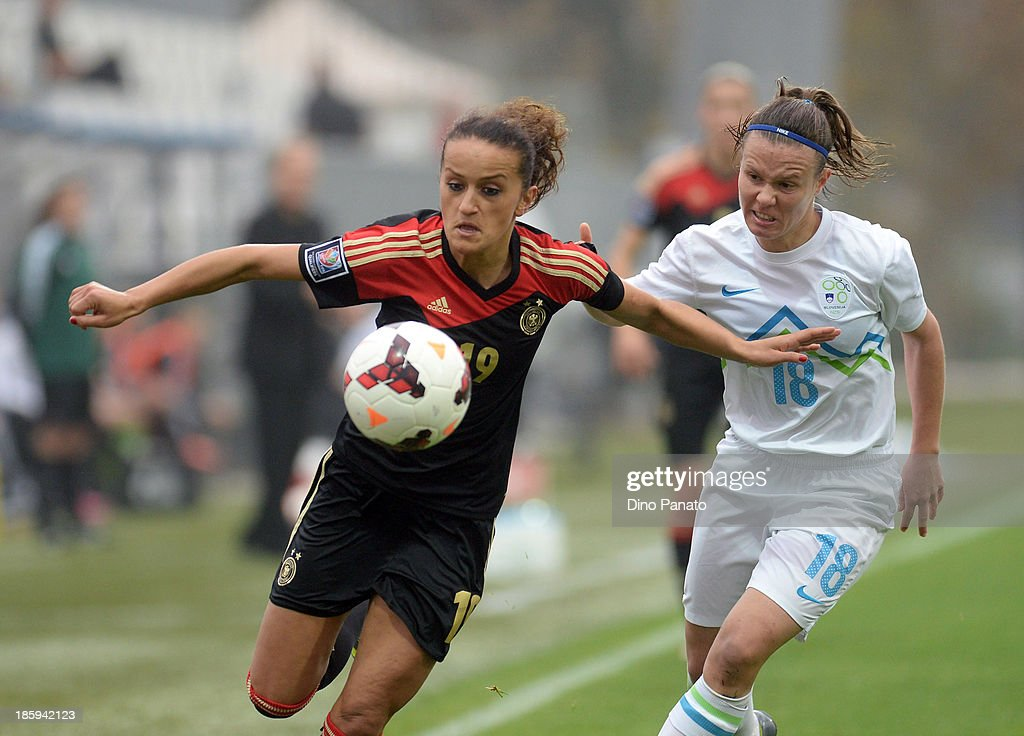 Tjasa Tibaut (R) of Slovenia competes with Fatmire Bajramaj of Germany during the Qualifying Round - FIFA Women's World Cup between Slovenia and Germany at SRC Bonifika stadio on October 26, 2013 in Koper, Slovenia.