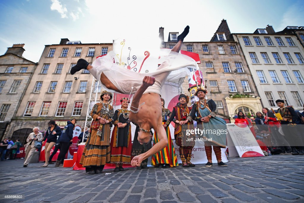 Tjimurdance theatre perform in the Edinburgh Festival Fringe on the Royal Mile on August 14, 2014 in Edinburgh, Scotland. The largest performing arts festival in the world, this year's festival hosts more than 3,000 shows in nearly 300 venues across the city.