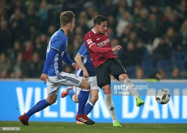 Tjorben Uphoff of Schalke and Edgar Prib of Hannover battle for the ball during the friendly match between Hannover 96 an FC Schalke 04 at HDIArena...