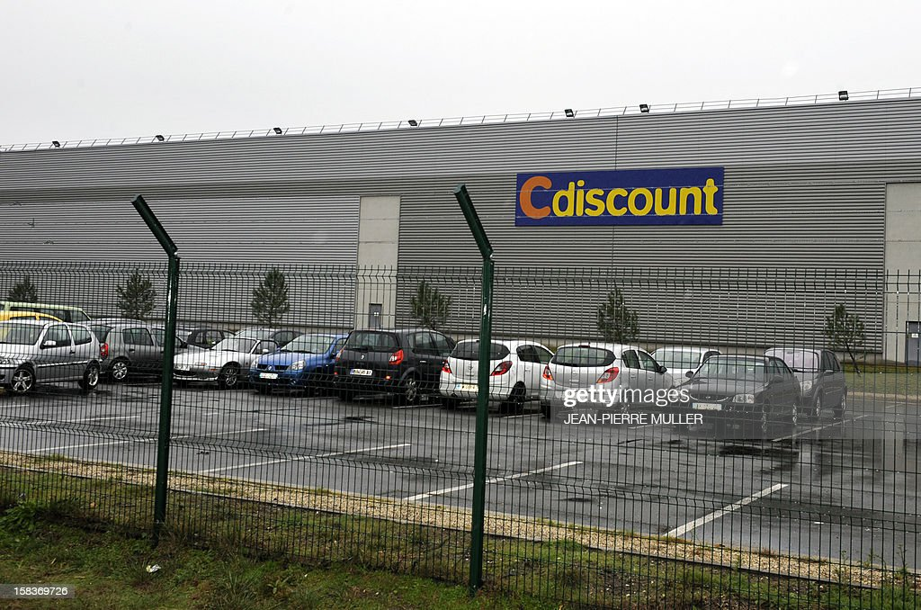 Tle logo of the French 'C Discount' online trade company is seen on the facade of the store in Cestas, southwestern France, on December 14, 2012.