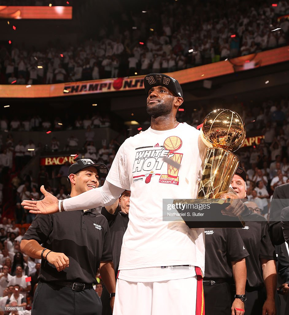 TLeBron James #6 of the Miami Heat holds the Larry O'Brien Championship Trophy after defeating the San Antonio Spurs in Game Seven of the 2013 NBA Finals on June 20, 2013 at American Airlines Arena in Miami, Florida.