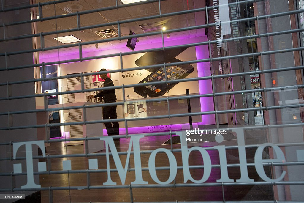 T-Mobile USA Inc. employees prepare to open a retail location in New York, U.S., on Friday, April 12, 2013. T-Mobile USA Inc., the fourth-largest U.S. wireless carrier, will begin offering Apple Inc.'s iPhone for the first time today, providing the biggest showcase yet for its new installment-plan approach to selling phones. Photographer: Scott Eells/Bloomberg via Getty Images
